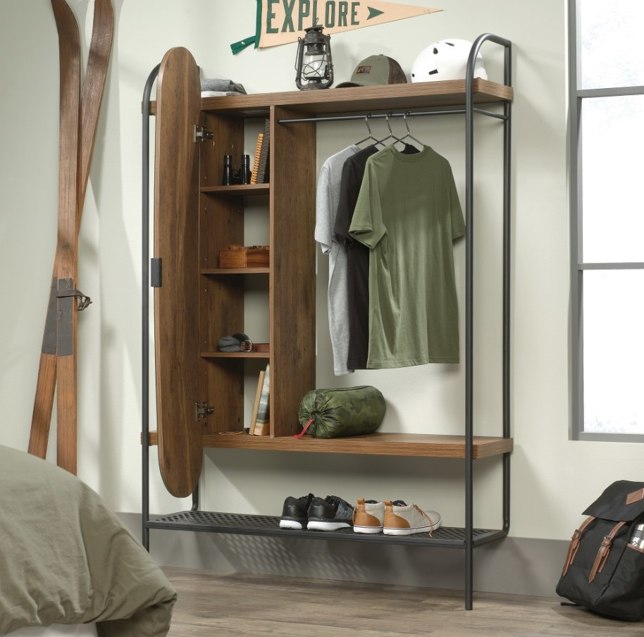 Wooden wardrobe with black hardware and open mirror closet