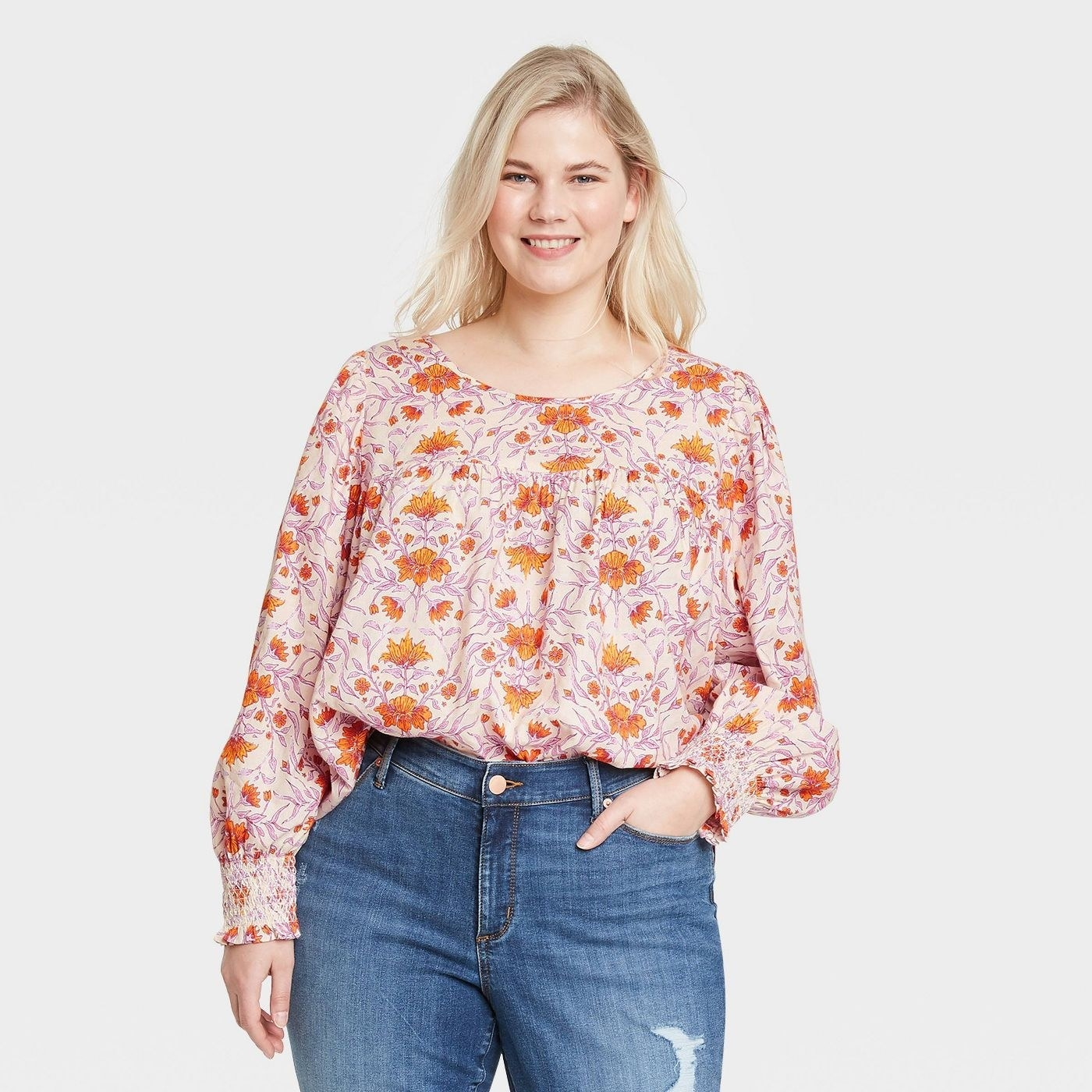 Model in floral balloon sleeve blouse