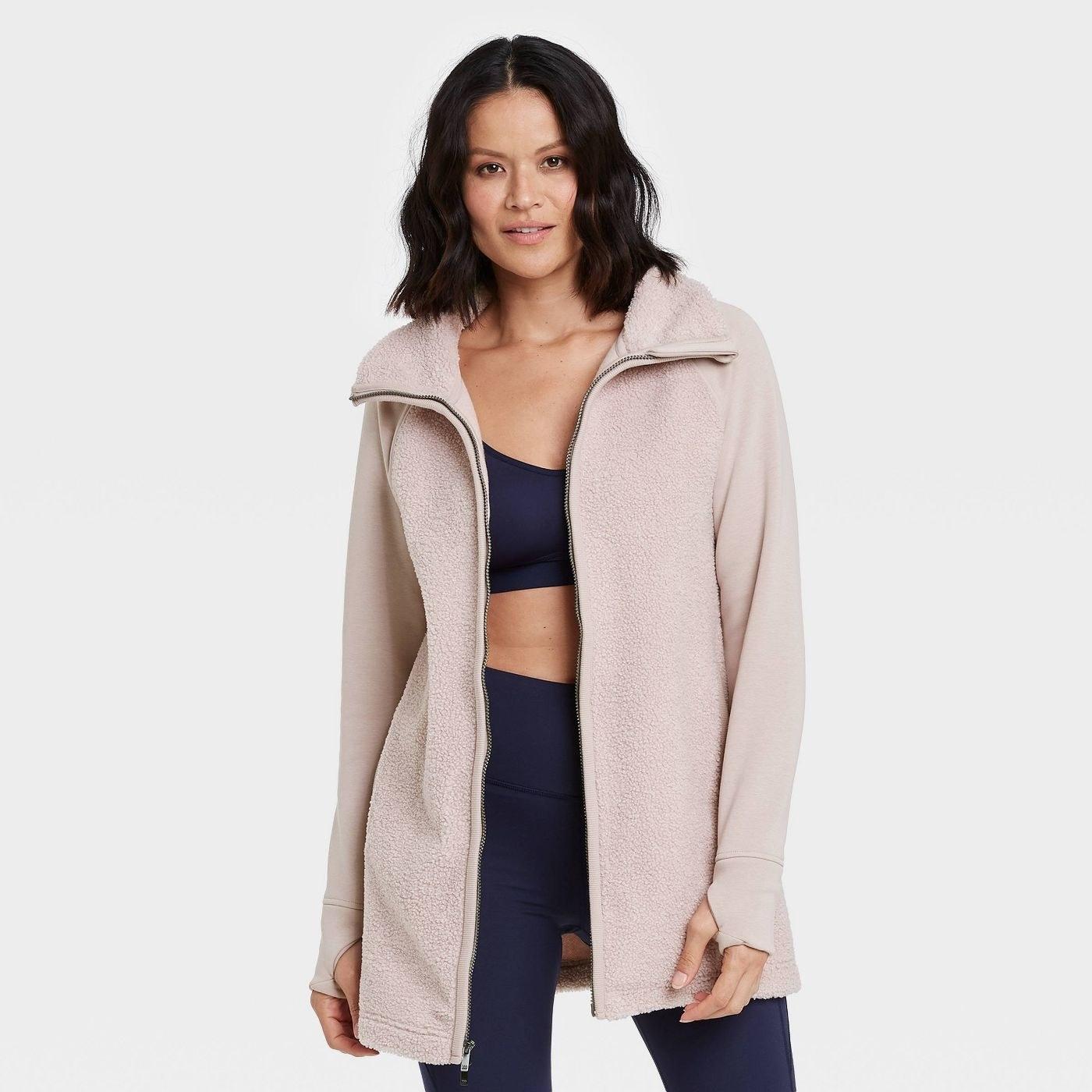 Model in long sherpa jacket