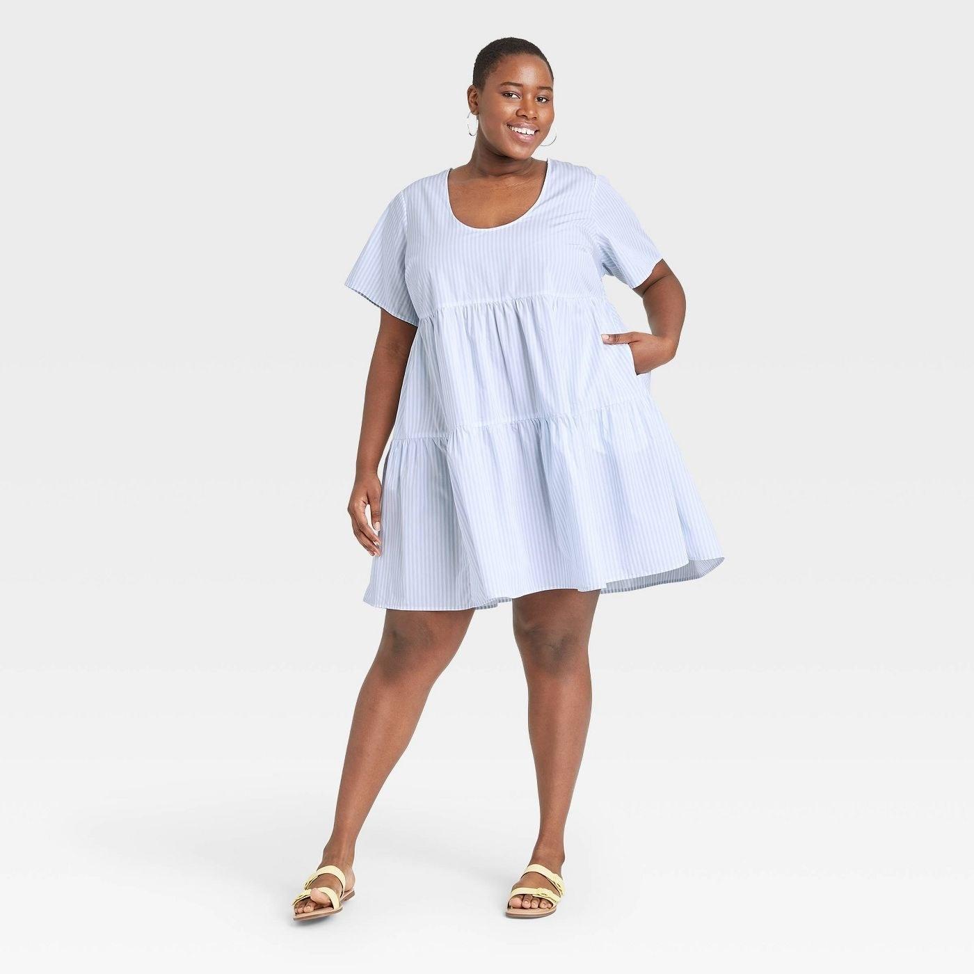model in short sleeve tiered dress