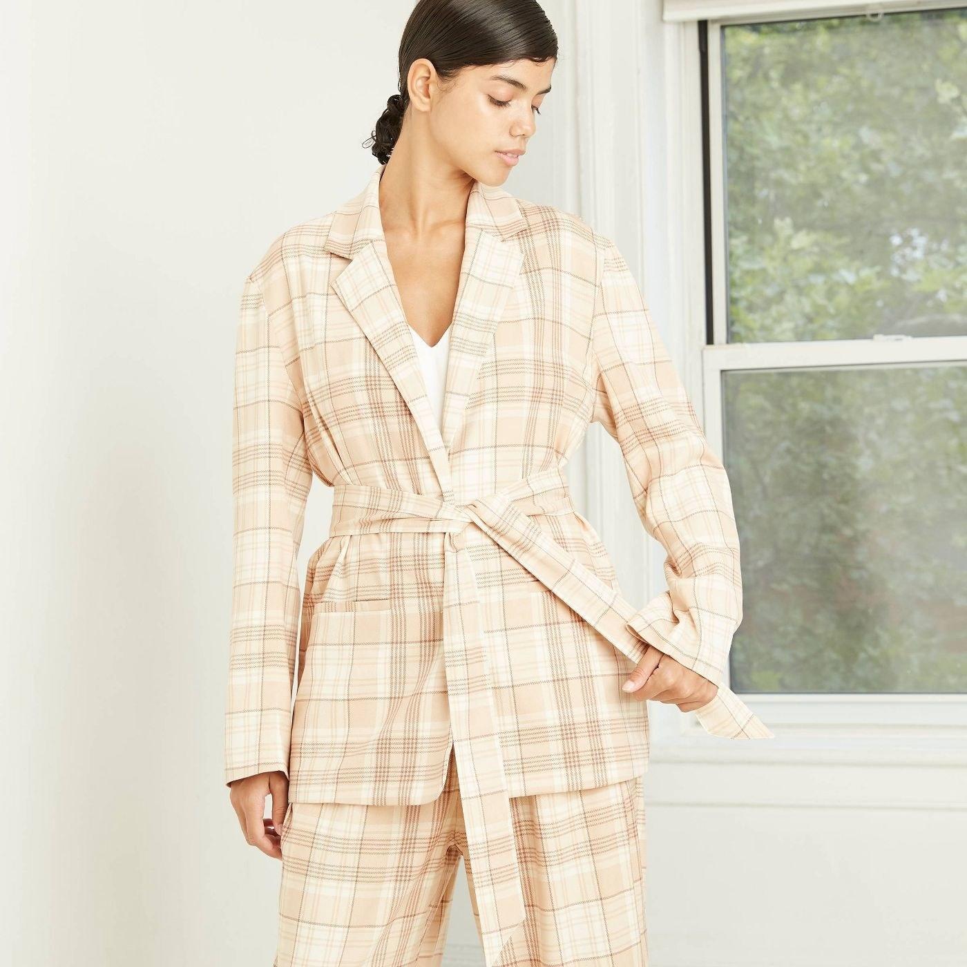 Model in plaid belted menswear blazer