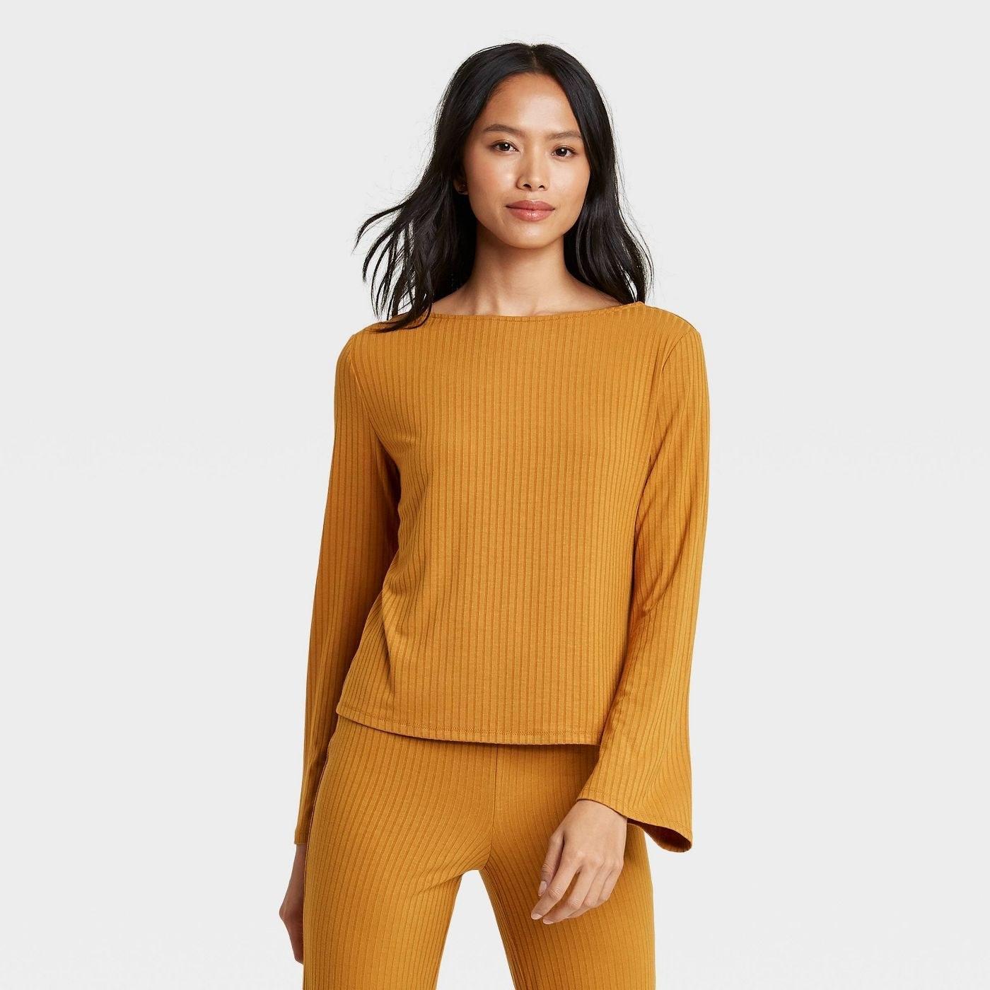 Model in long-sleeve boat-neck T-shirt