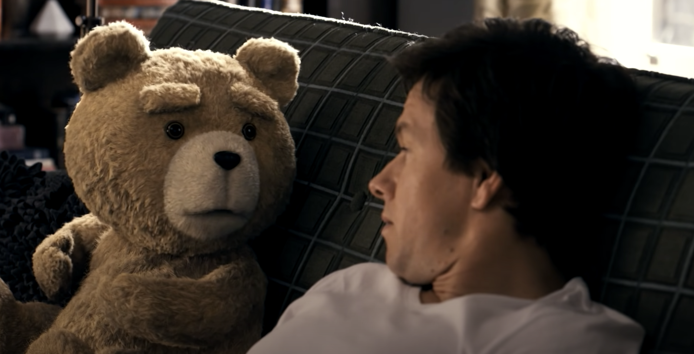 Ted the bear and Johnny sitting on their couch in Ted