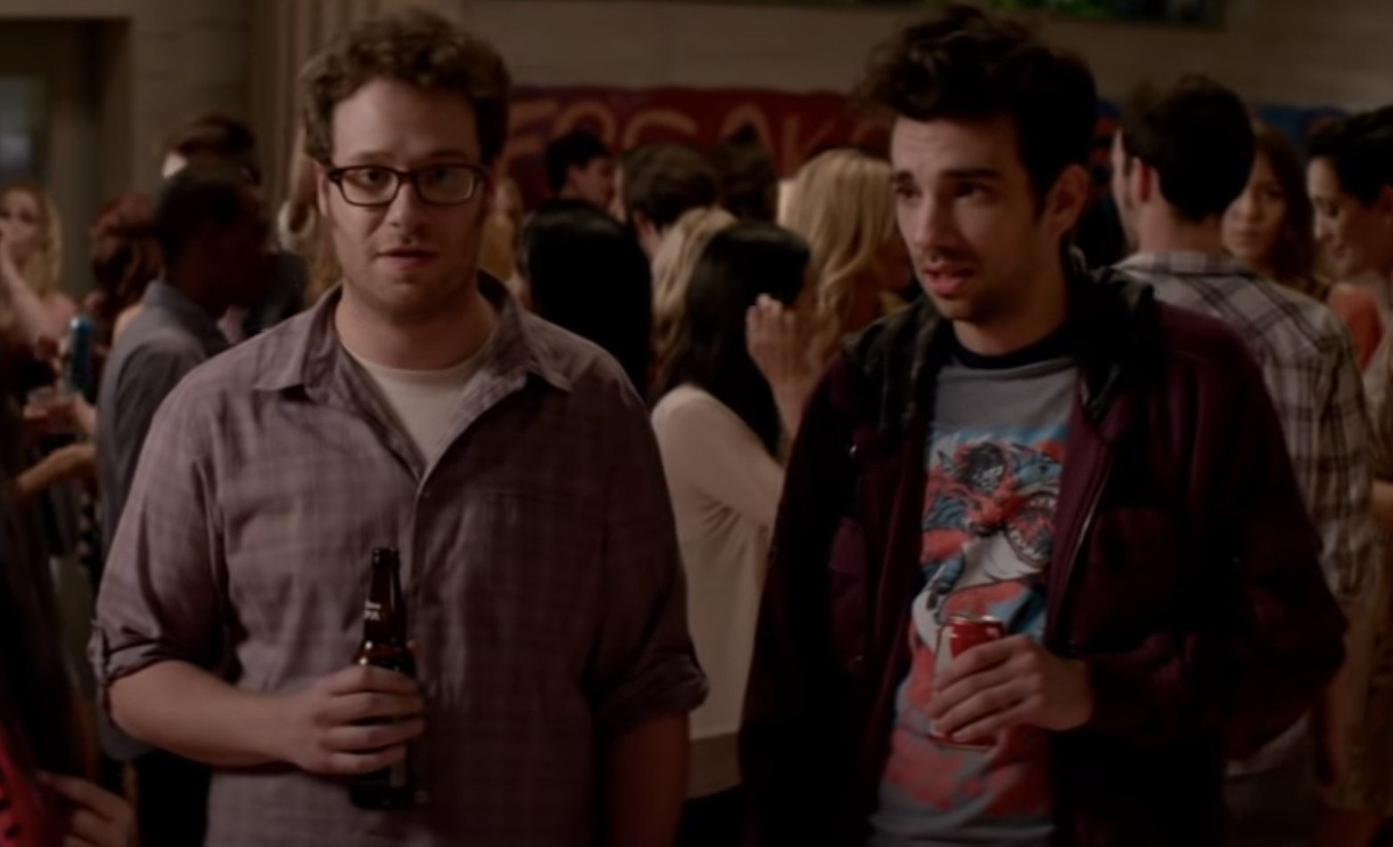 Seth Rogen and Jay Baruchel at a party in This is the end