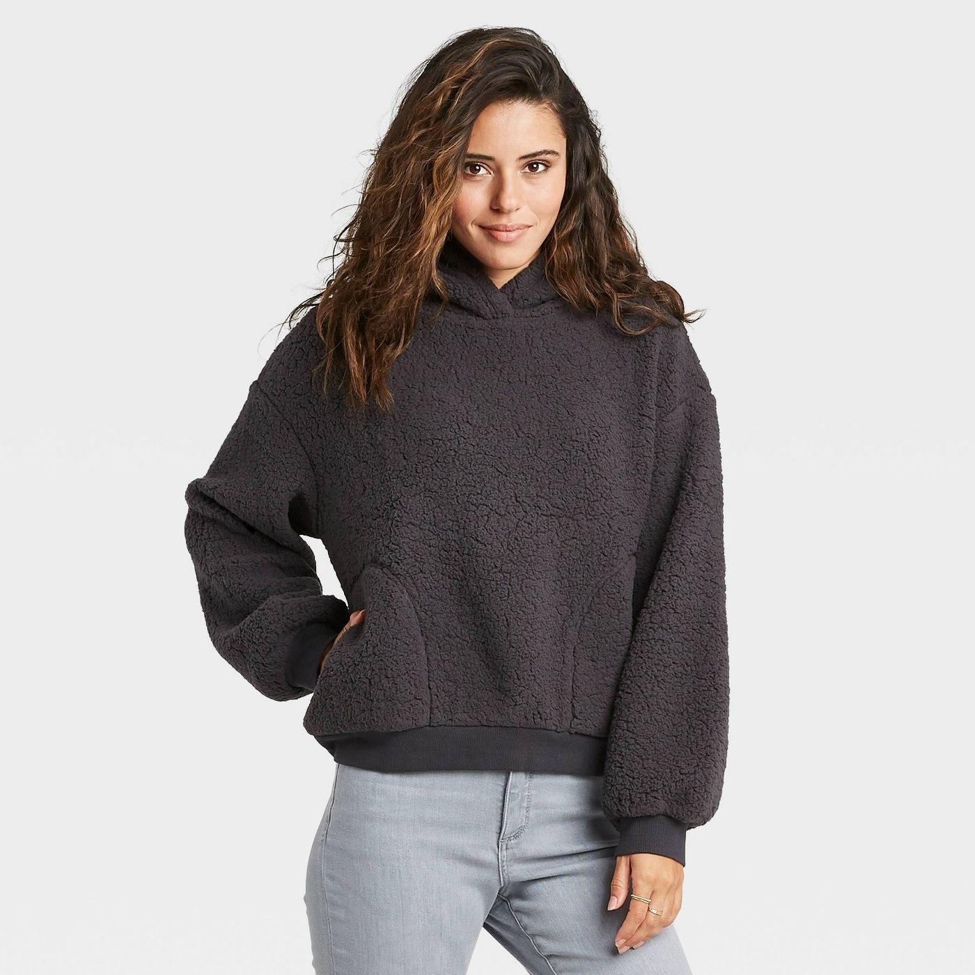 Model in sherpa sweatshirt