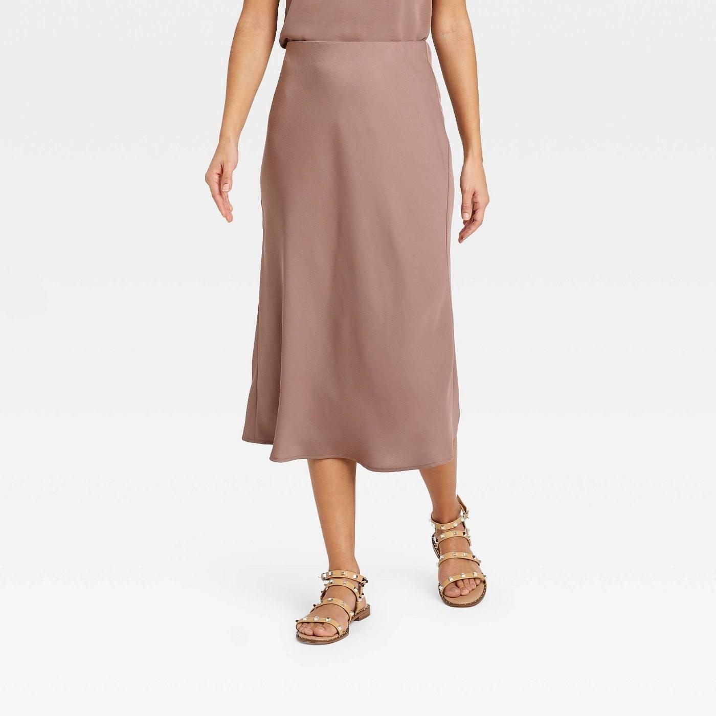 Model in high-rise midi slip skirt
