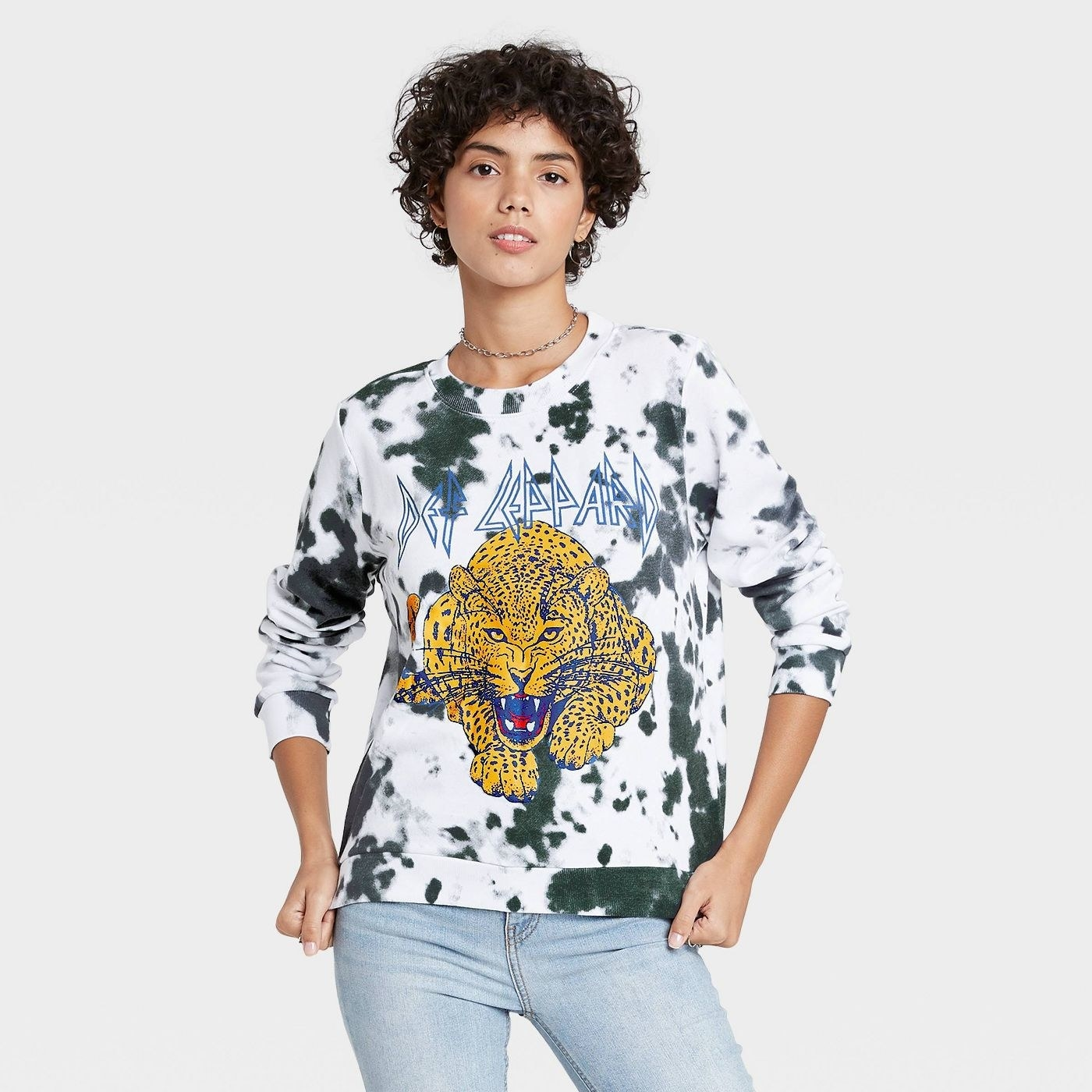 Model in Def Leppard graphic sweatshirt