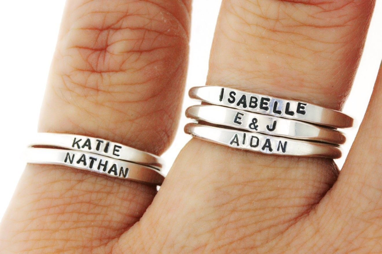 A few of the stackable rings with different names embossed