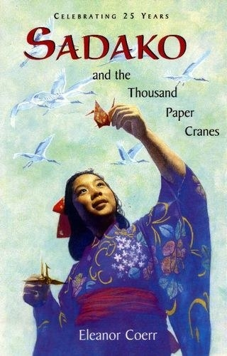 Cover shows a young woman in traditional Japanese dress holding two paper cranes as real ones fly above her head