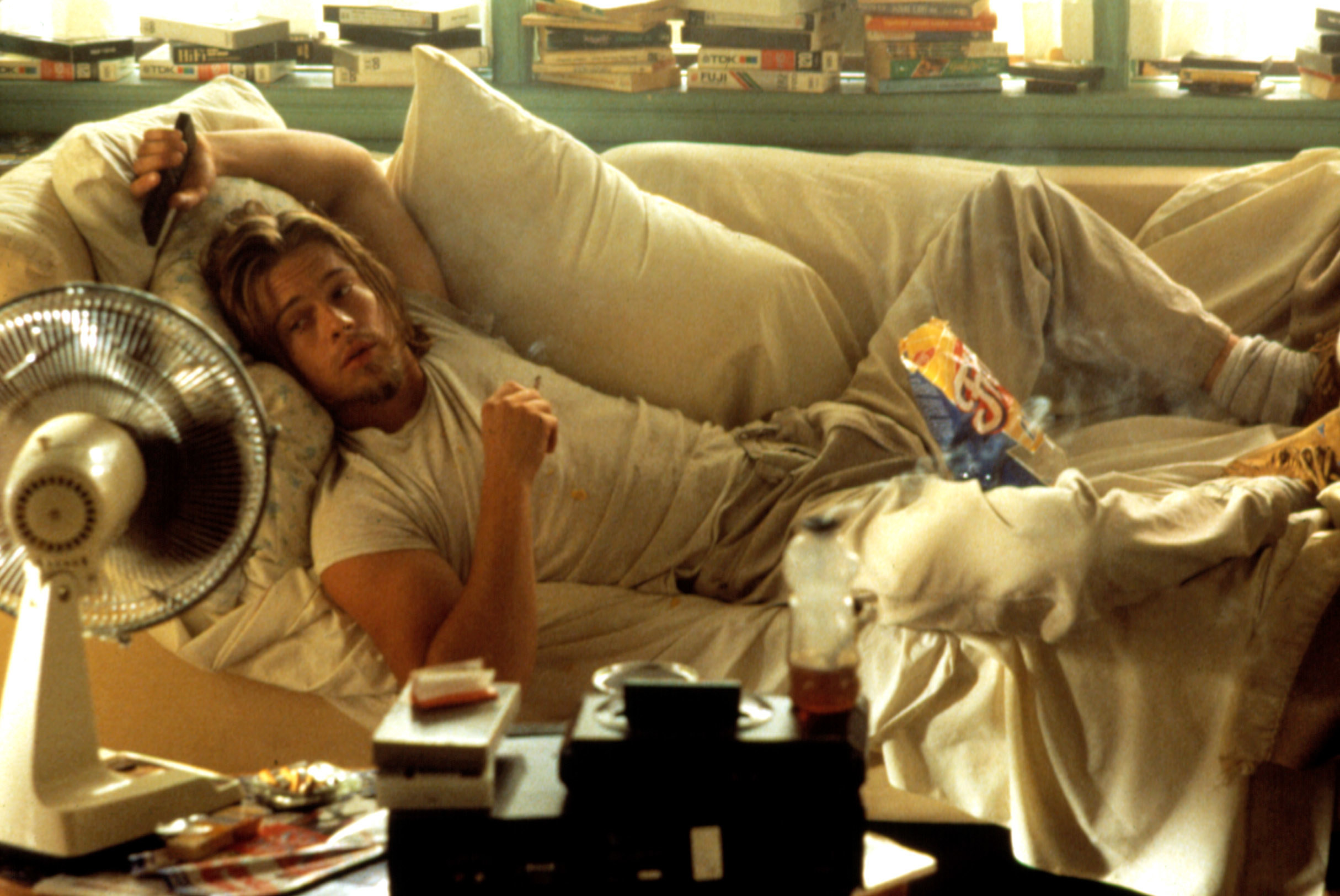 Brad Pitt lounging on a couch in True Romance