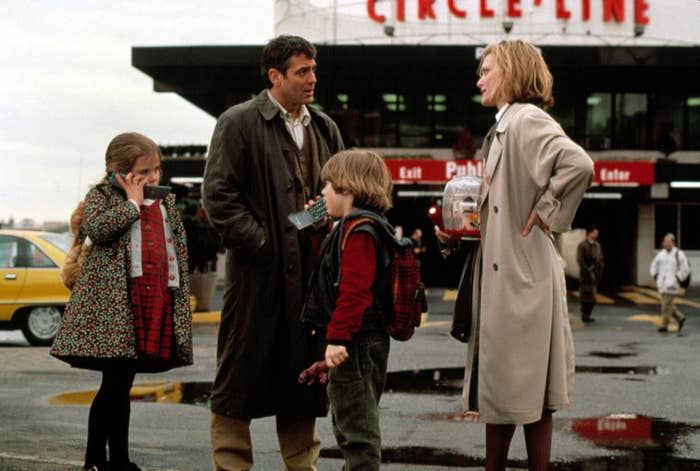 Michelle Pfeiffer and George Clooney speak to one another while their children, played by Mae Whitman and Alex. D. Linz, play on flip phones