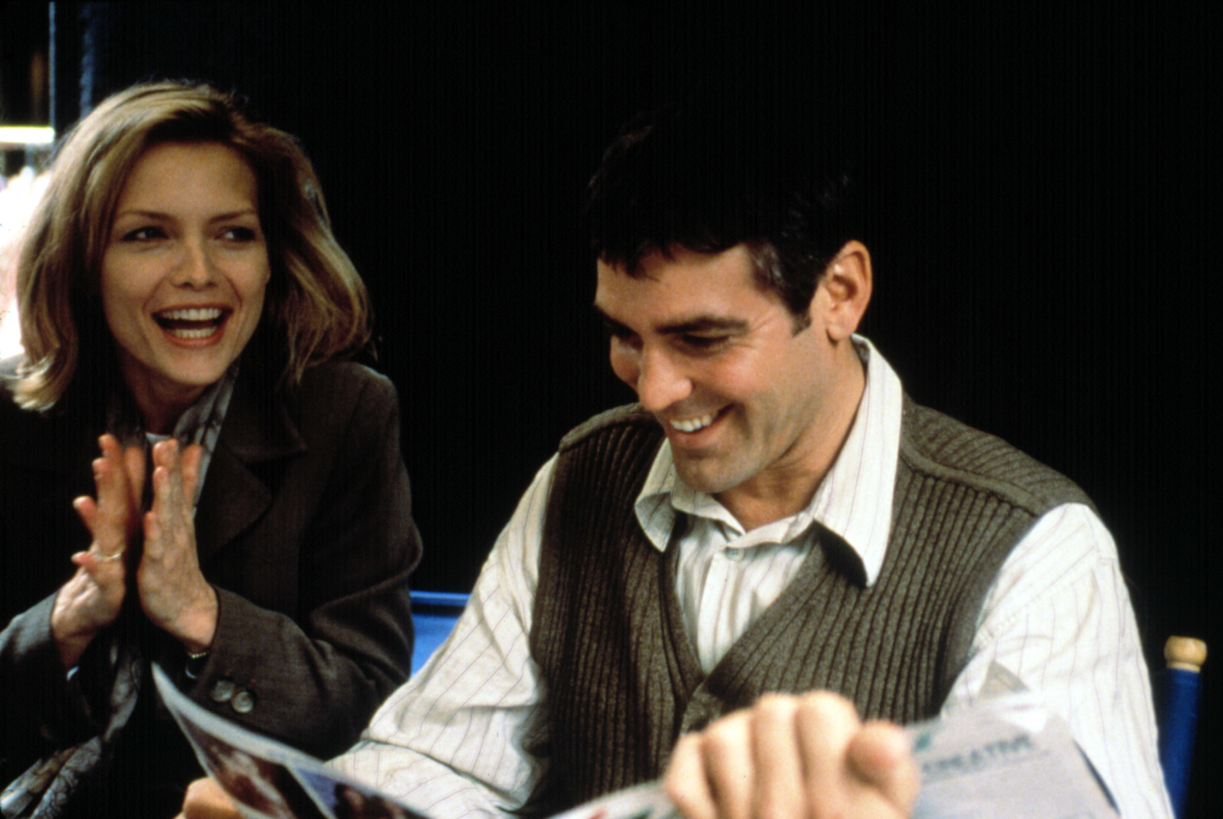 Michelle Pfeiffer and George Clooney laughing together in One Fine Day