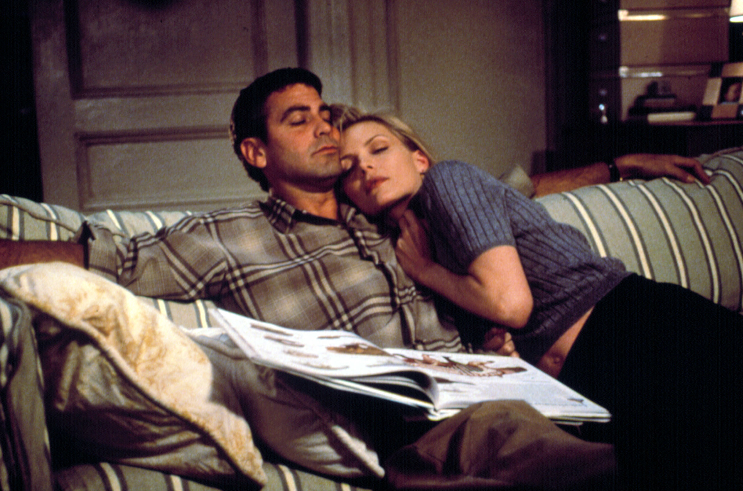 George Clooney Michelle Pfeiffer sleeping on a couch in each other's arms