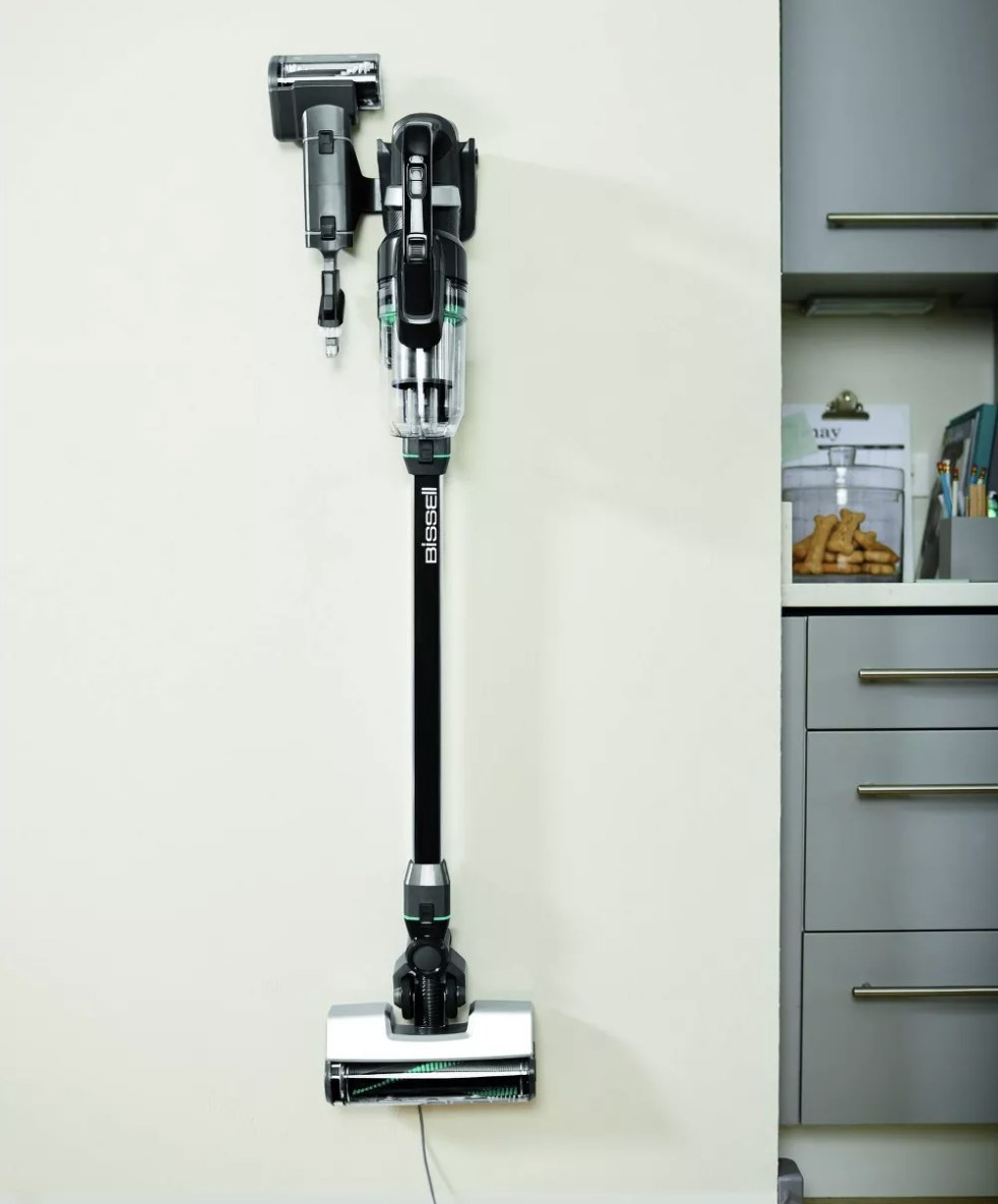 A vacuum mounted on the wall
