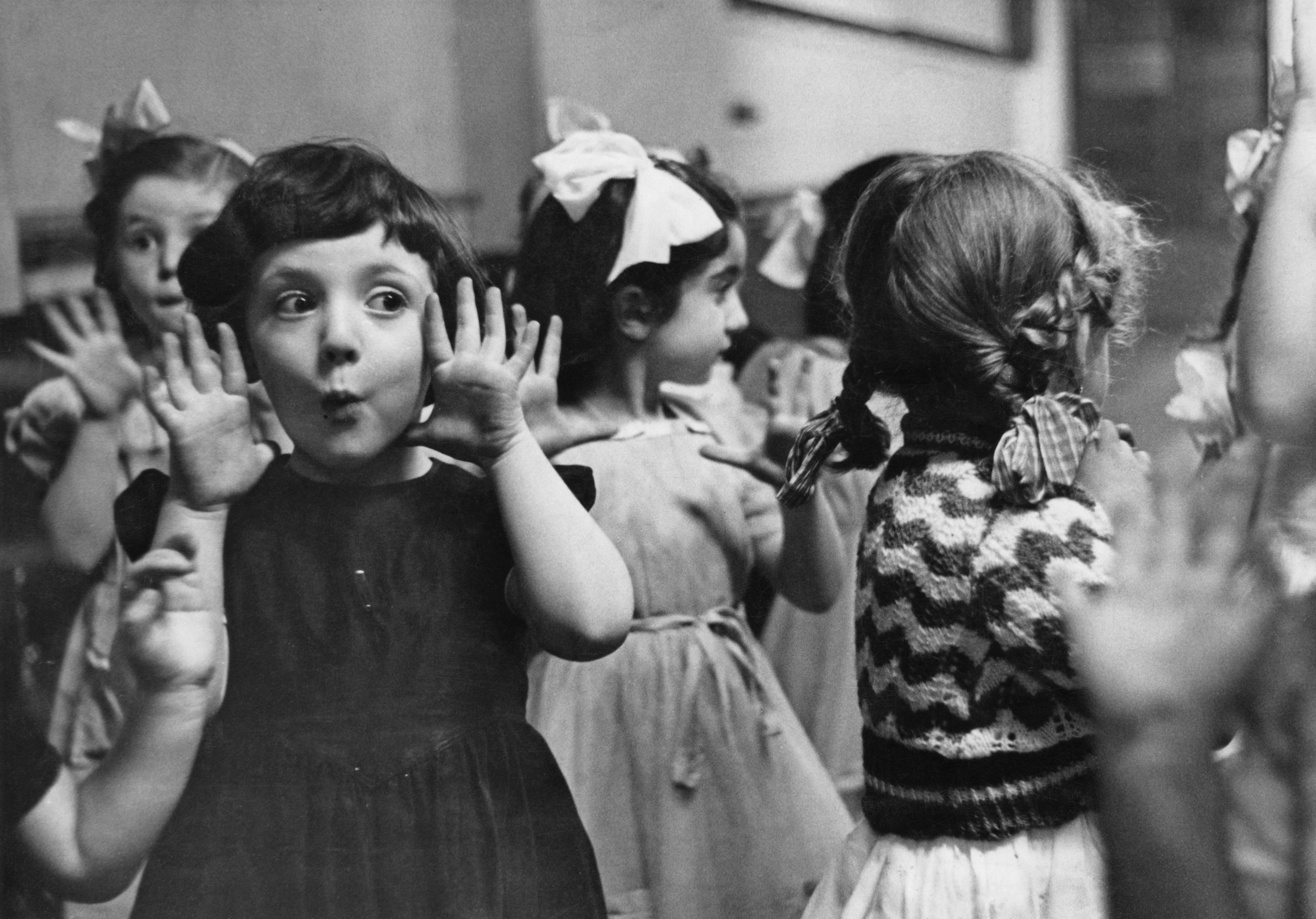 Young girls making faces in a vintage photo