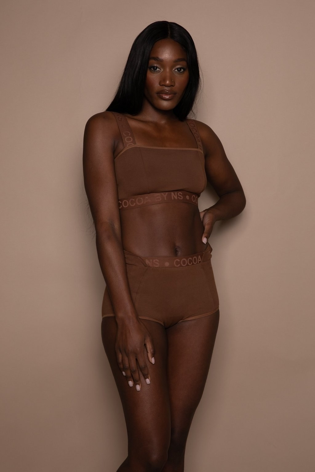 A model in a bralette and boyshorts that match their skin tone