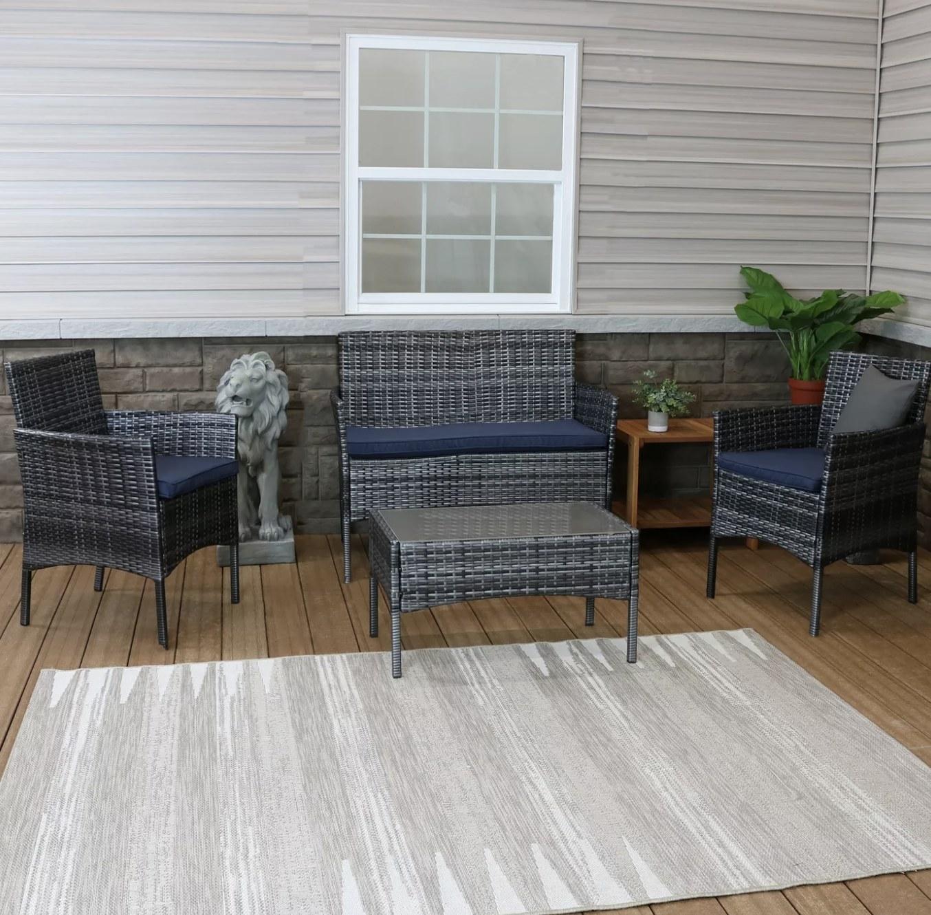The four-piece rattan patio set