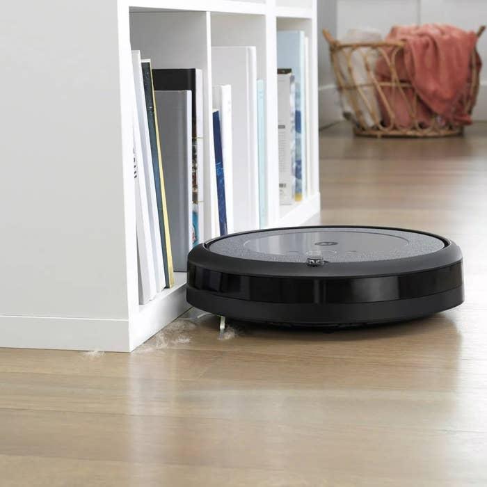 A black iRobot vacuum