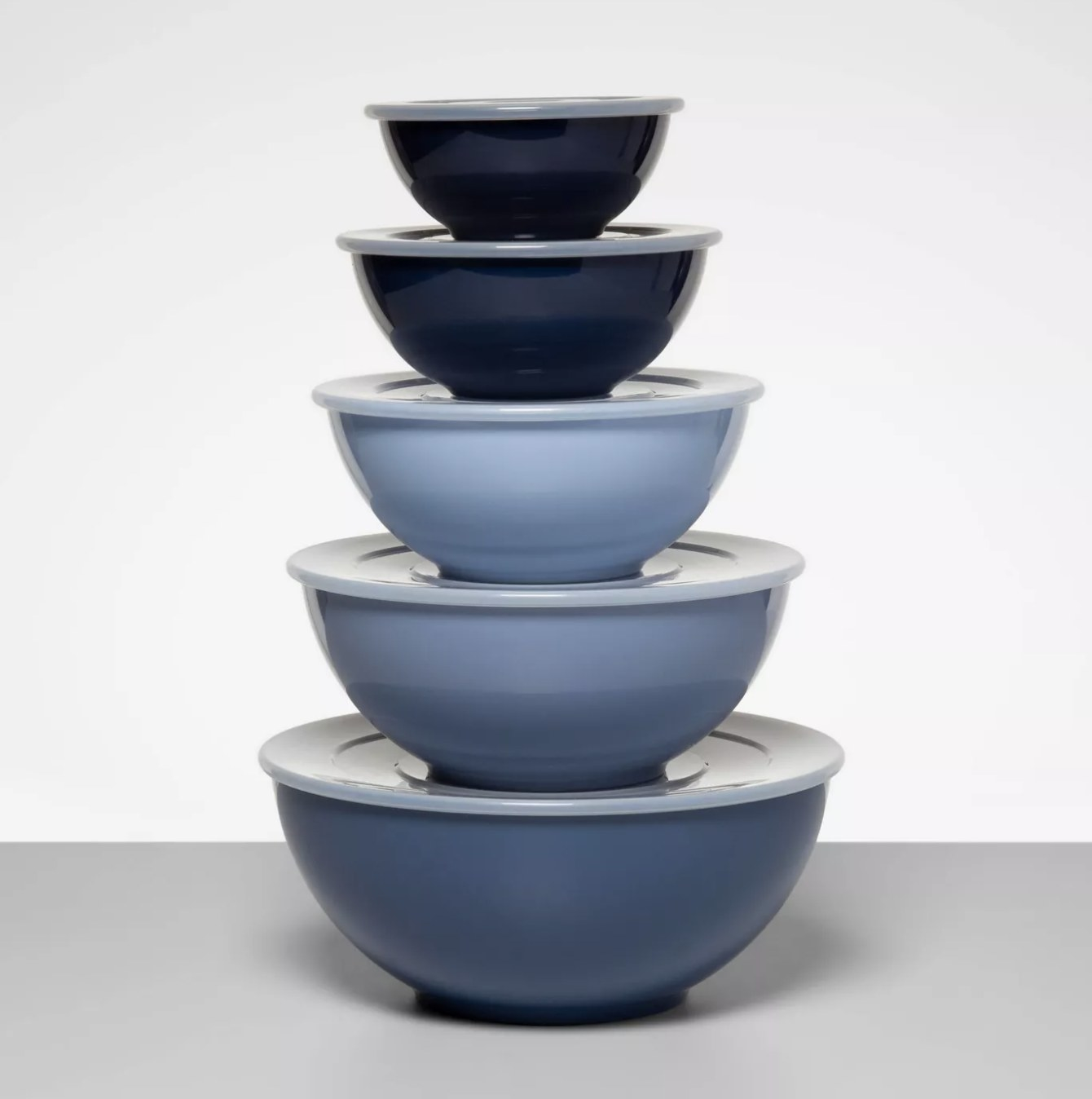 The pale blue mixing bowls stacked with lids