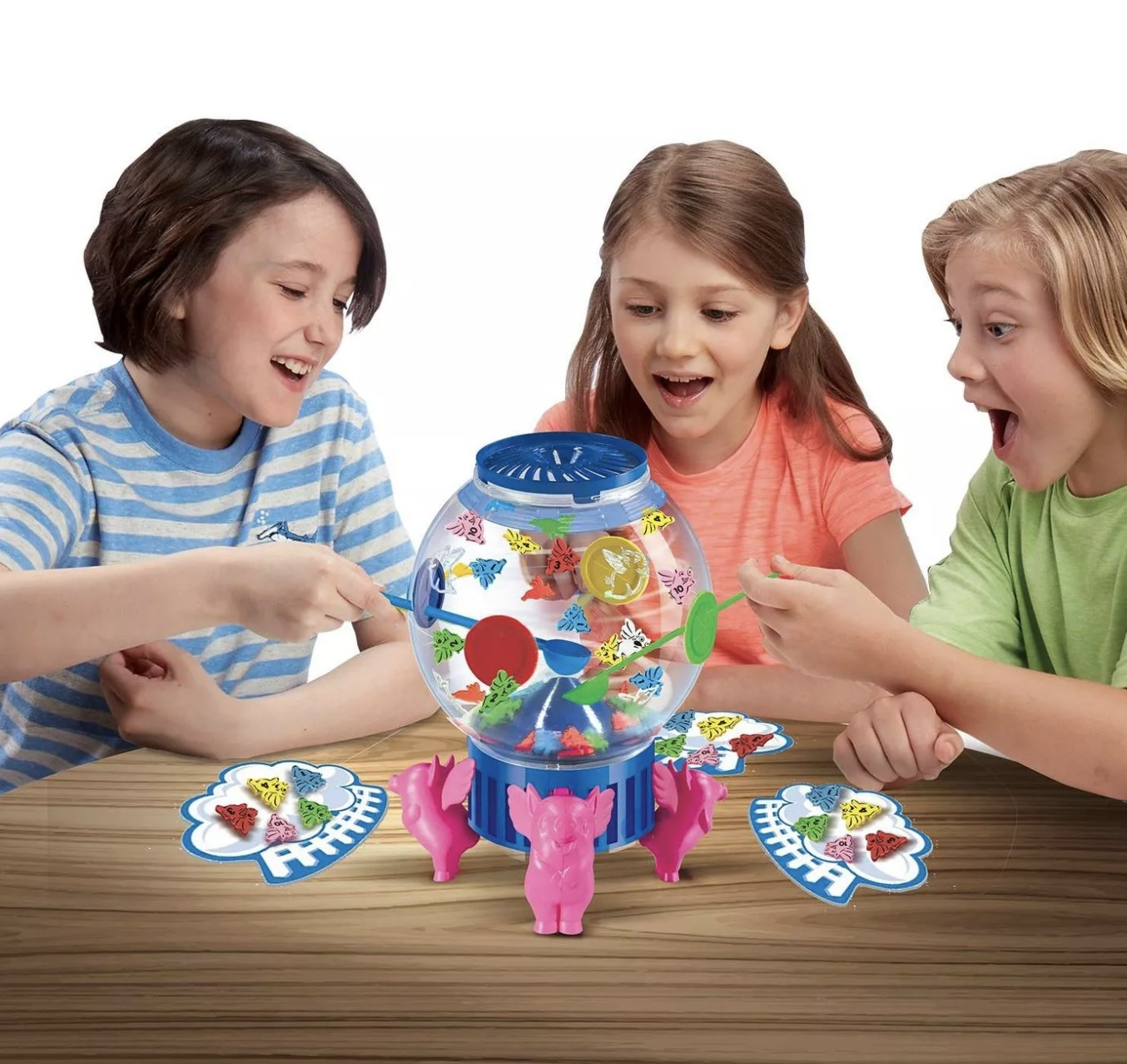 Three young people playing the Flying Pigs game