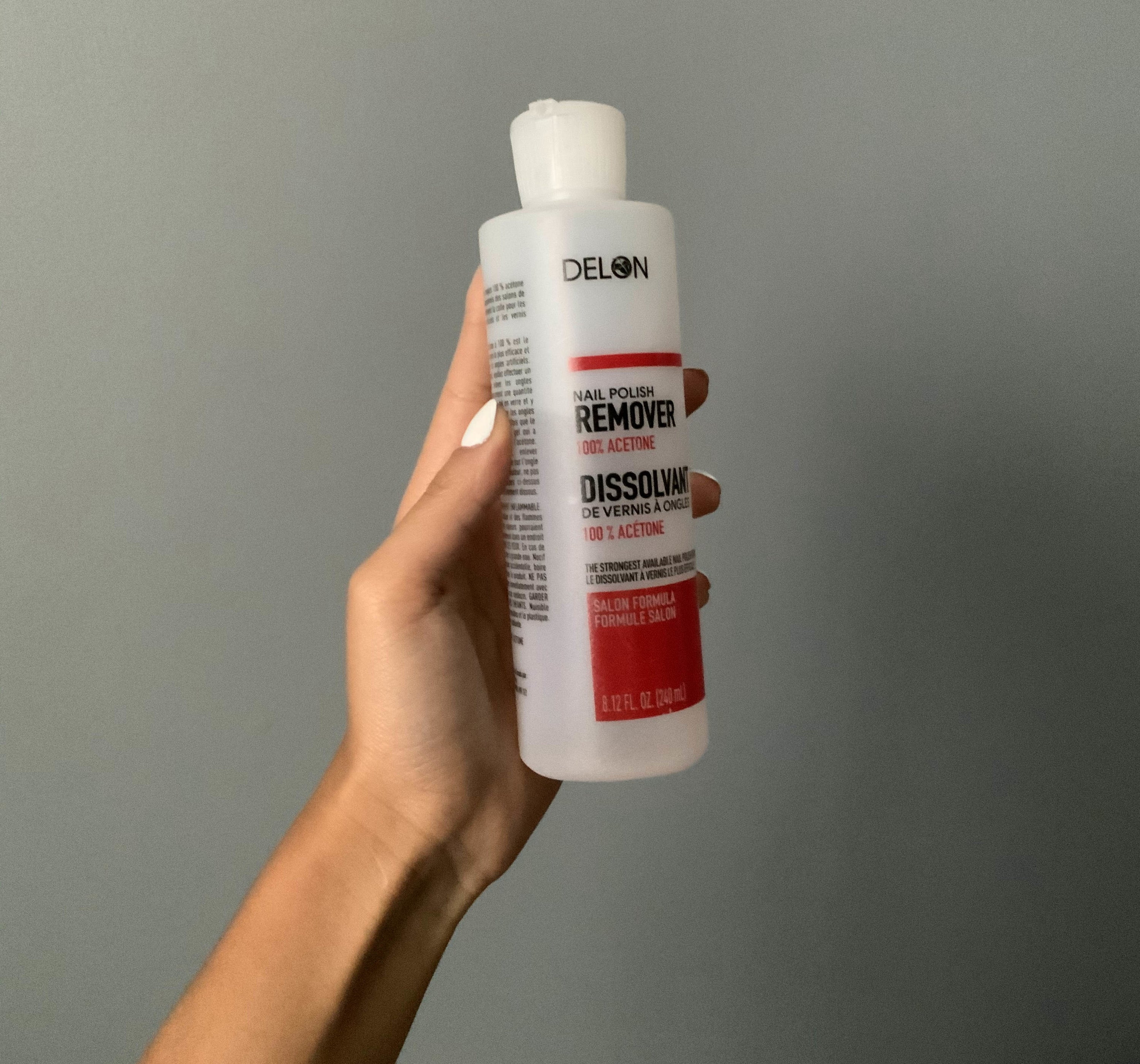 BuzzFeed employee holding bottle of nail polish remover