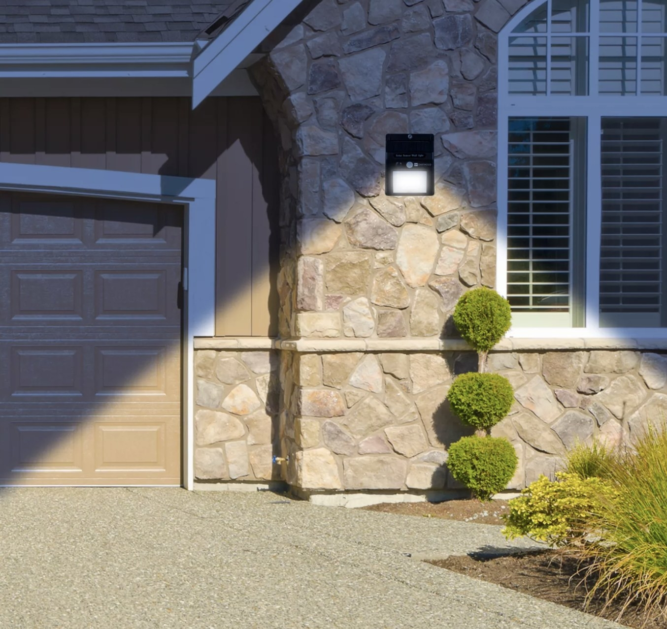 The motion sensor light next to a garage door