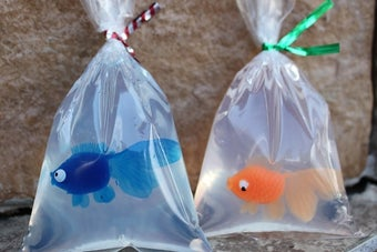 two soaps in bags with plastic goldfish inside