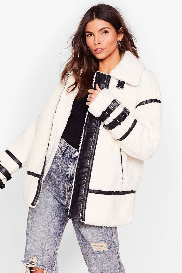 model wearing the white and black jacket