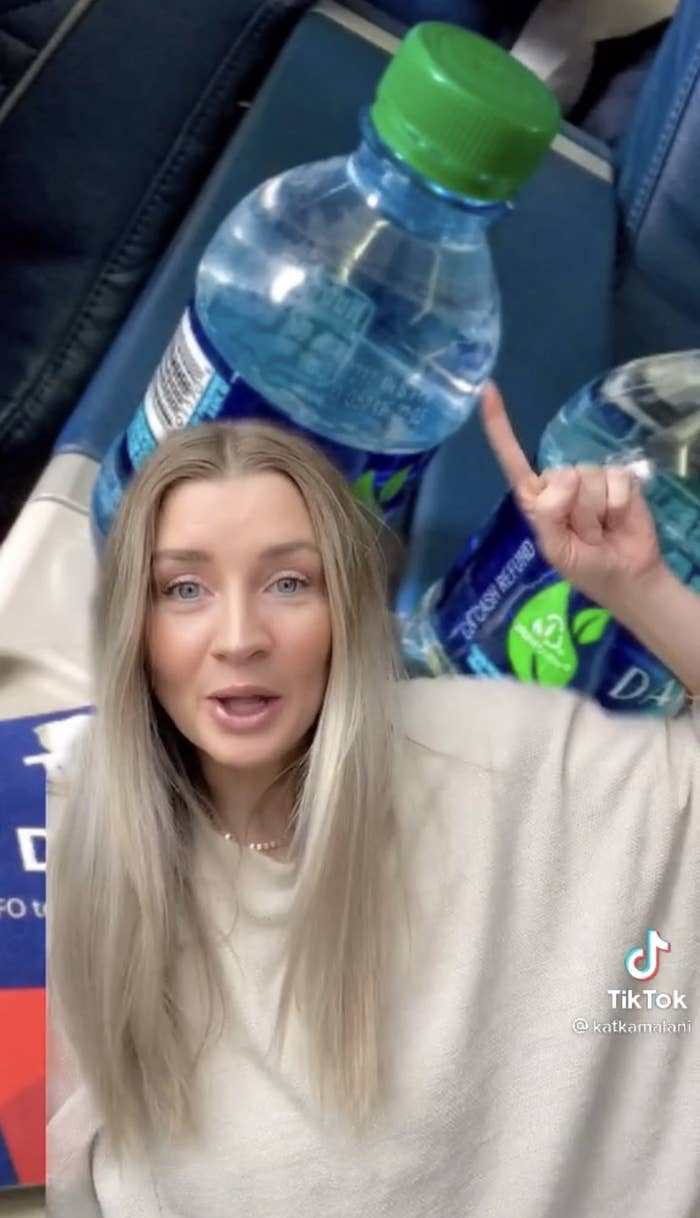 Kat pointing to a bottle of water