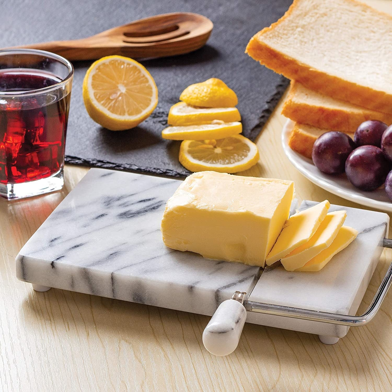 The marble cheese slicer with a block of cheese on top