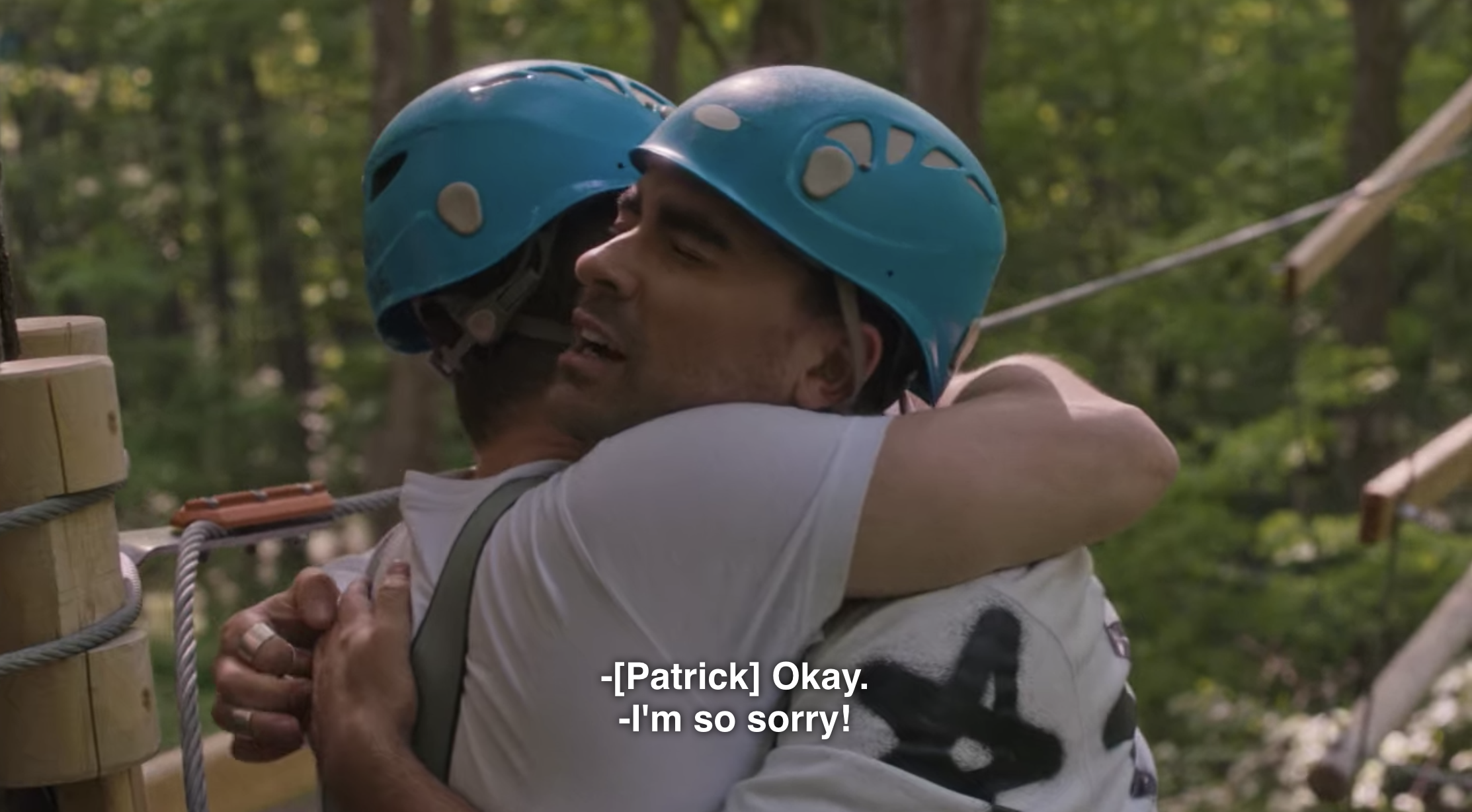 David and Patrick hugging on the ropes course on Schitt's Creek