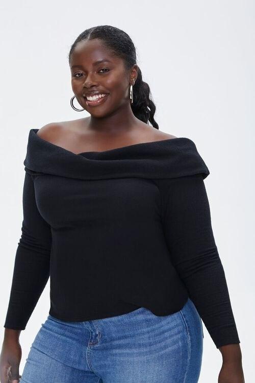 model wearing the black off shoulder top