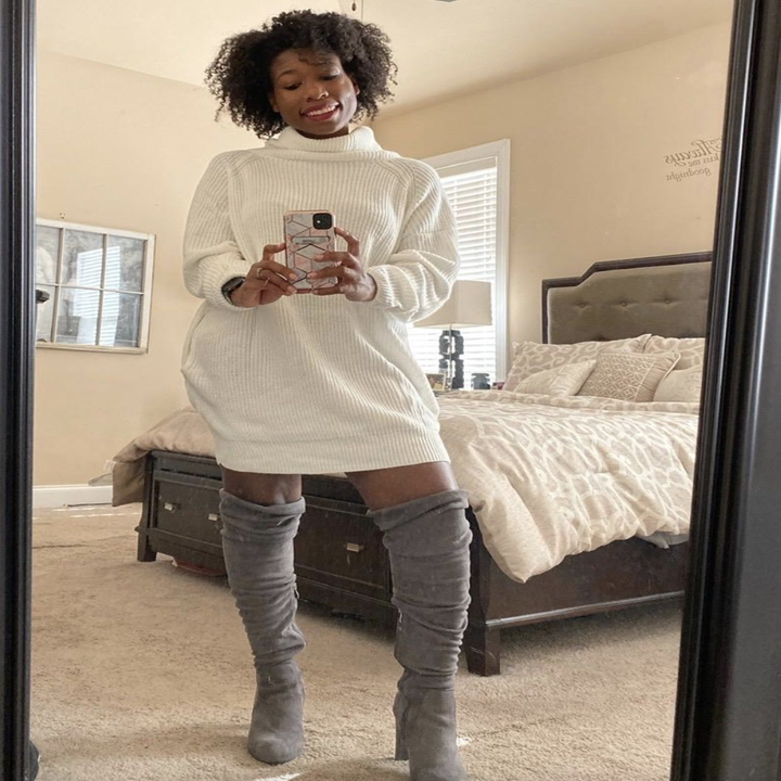 reviewer wearing the white sweater dress with gray over-the-knee boots