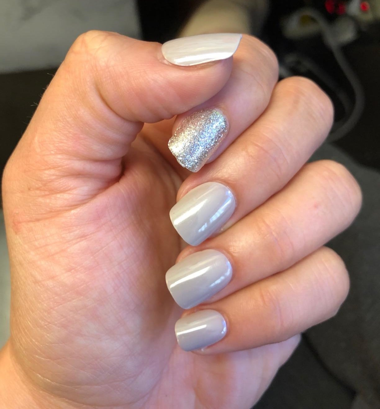 Reviewer with press-on nails