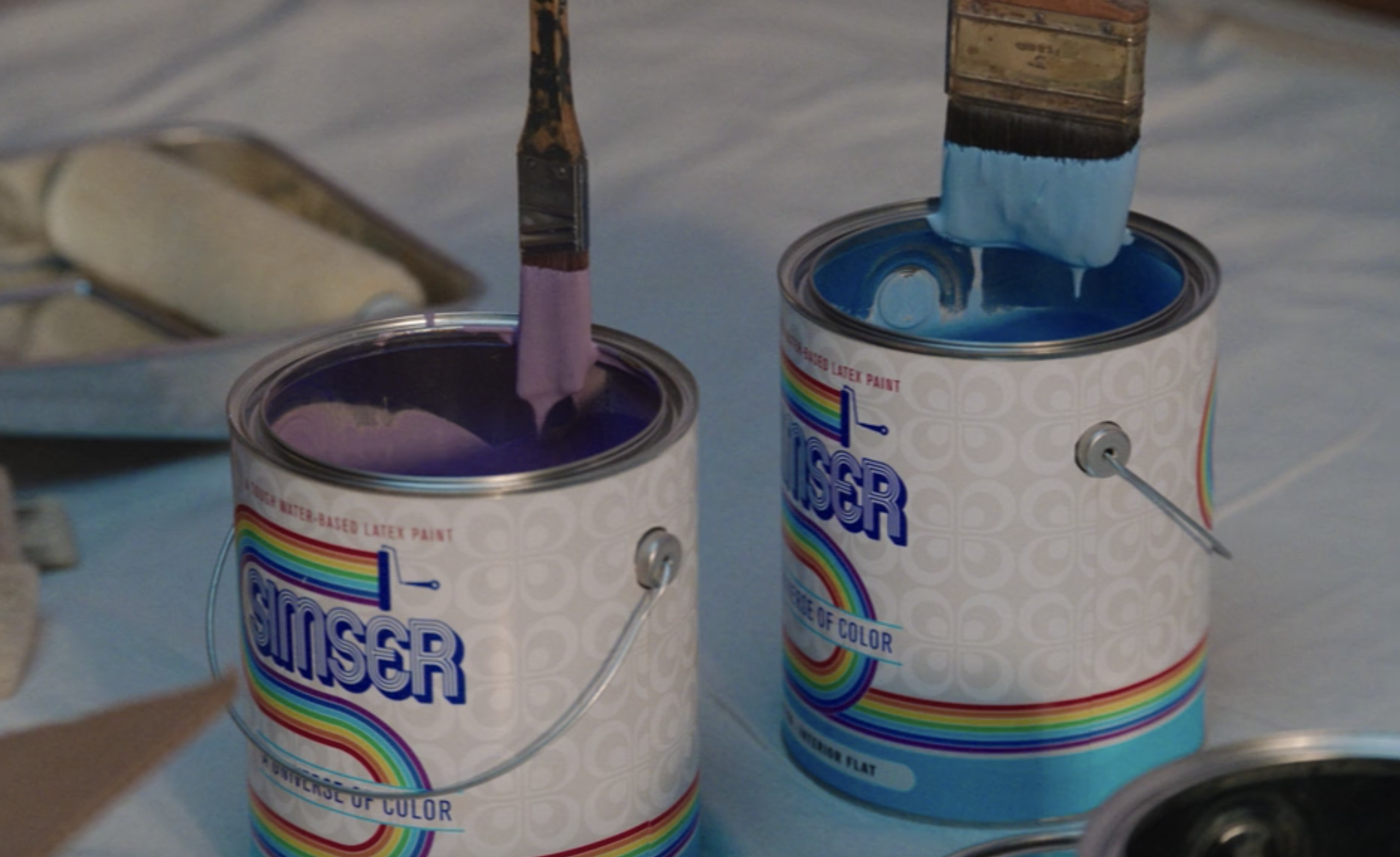 "Purple and blue paint cans that say, ""Simser"""