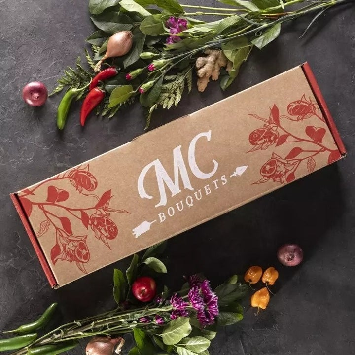 The decorative elongated box the bouquet comes in