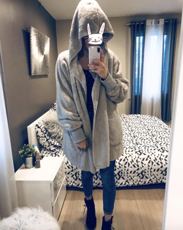 reviewer wearing the grey blanket hoodie