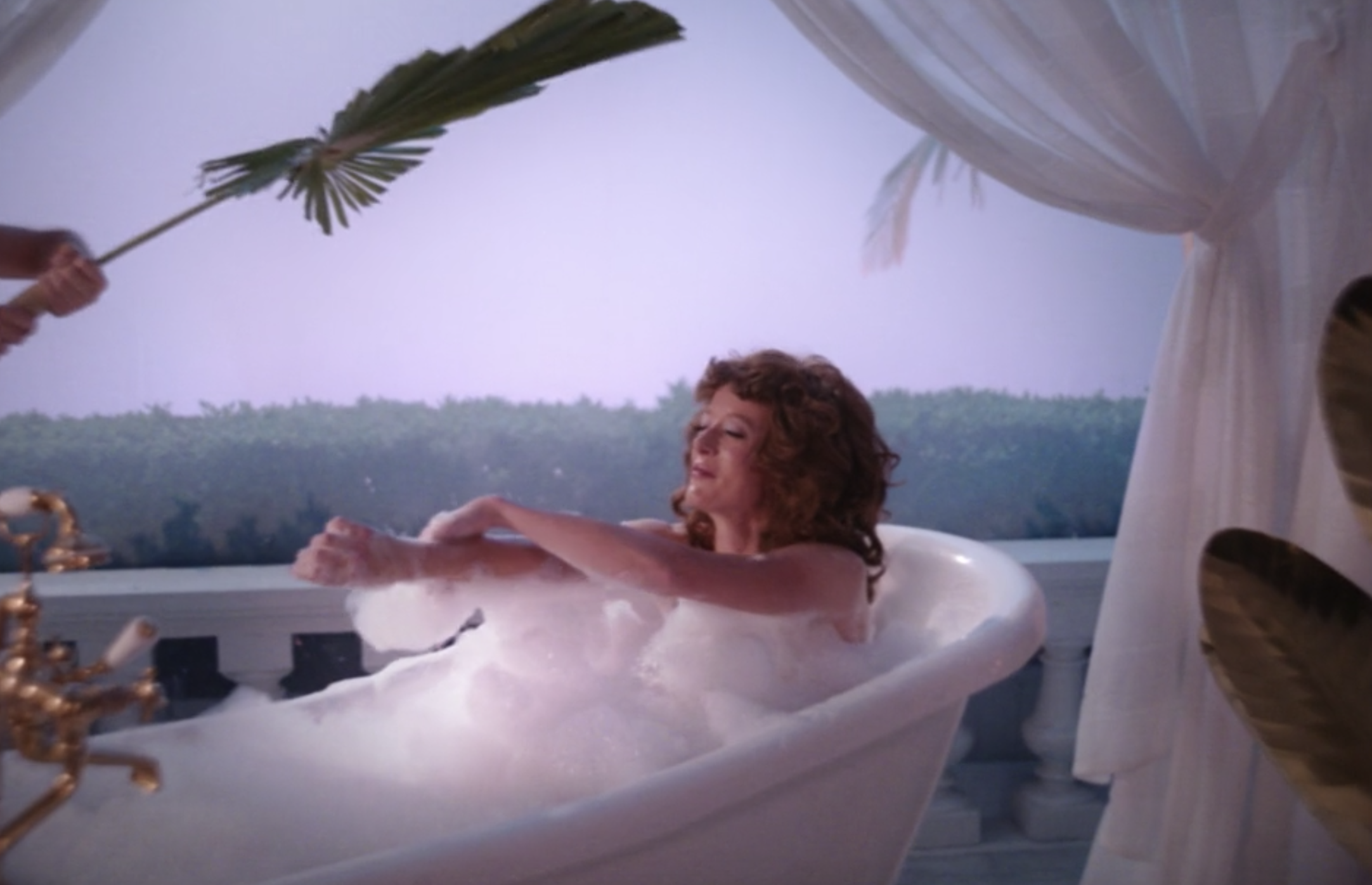 A woman taking a bath in the Hydra Soak commercial