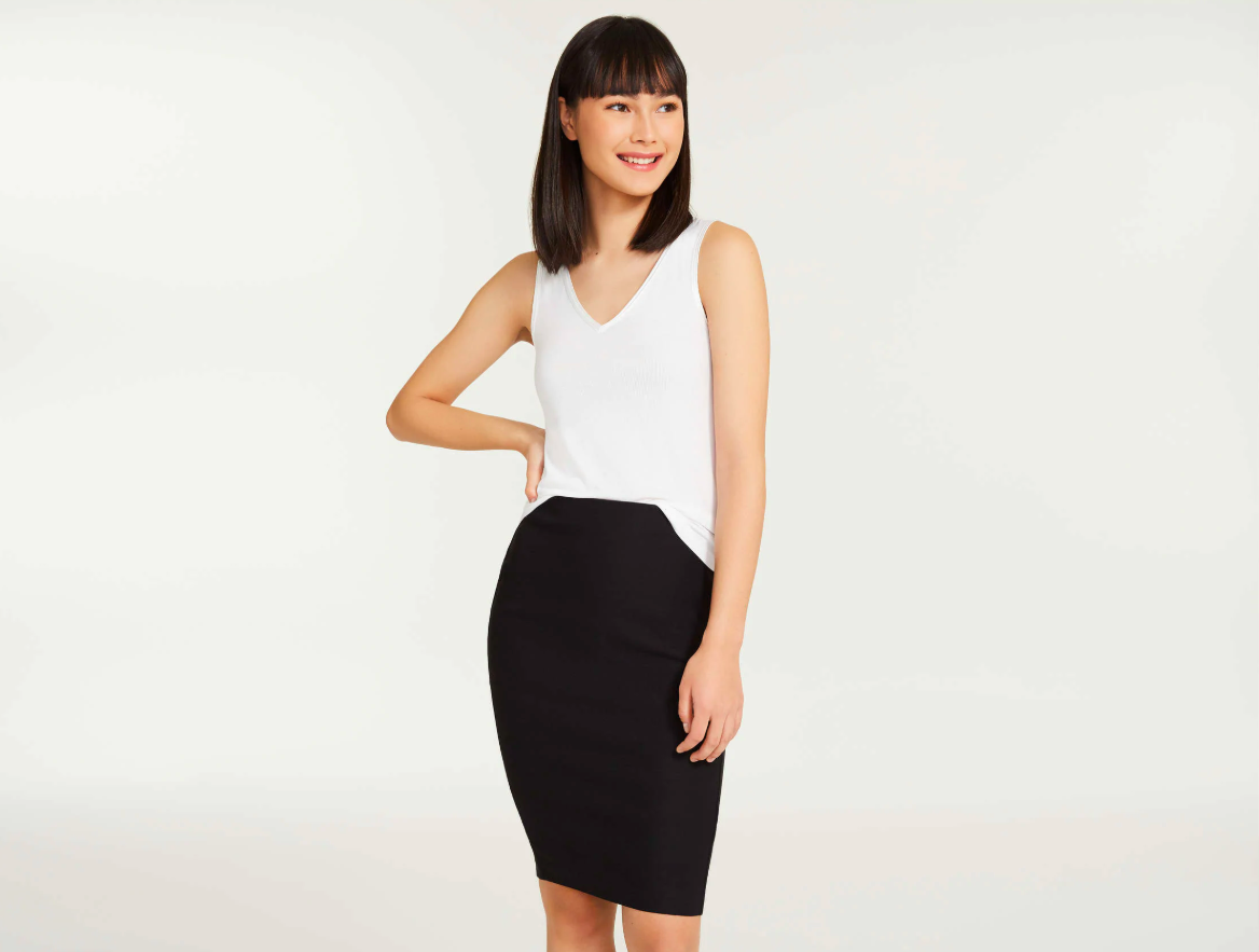 A person wearing a tank top and a fitted pencil skirt