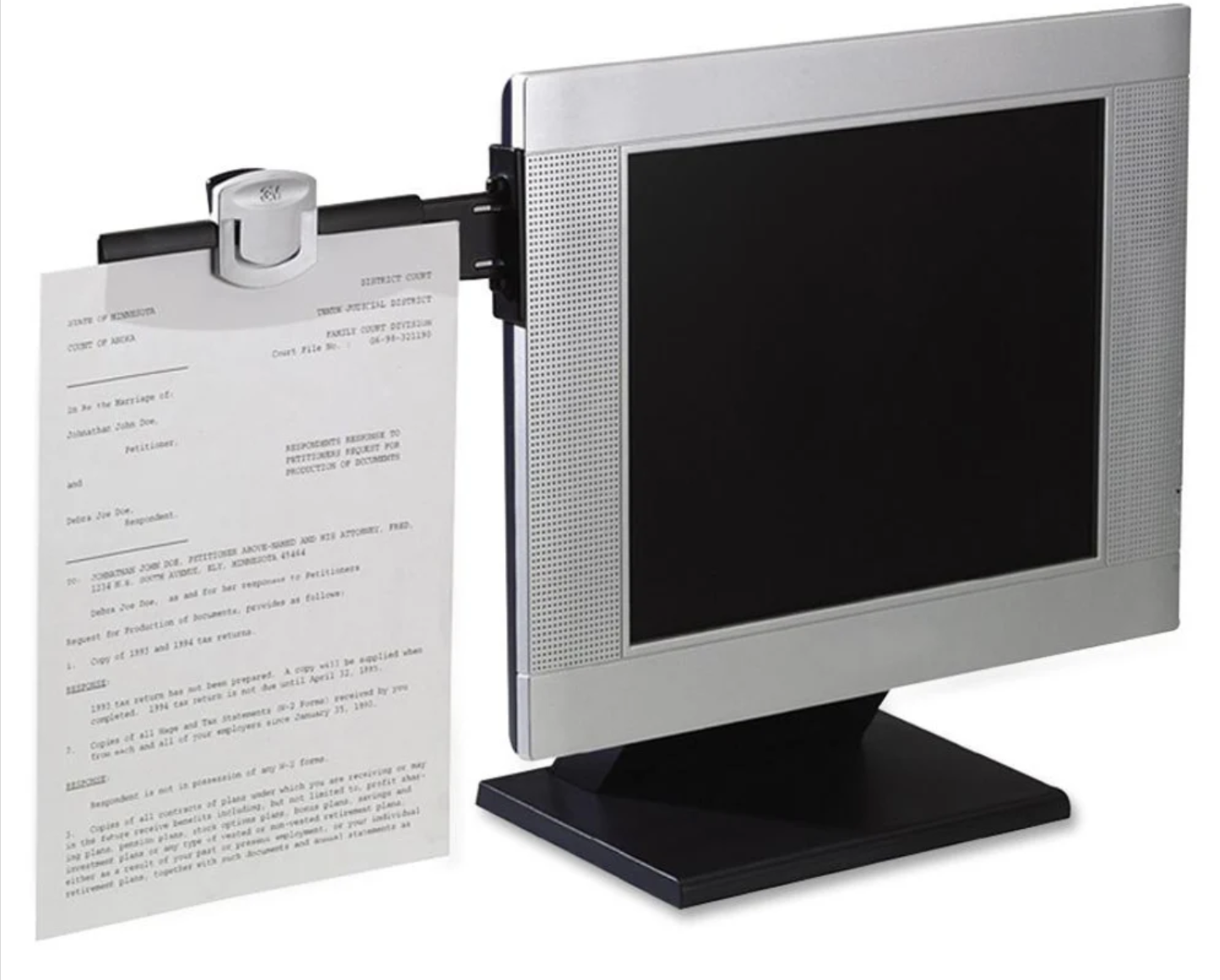 the 3M Monitor-Mount Dual Document Clip attached to a monitor with a document clipped to it