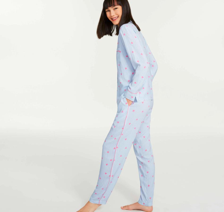 A person wearing a matching pyjamas shirt and pants