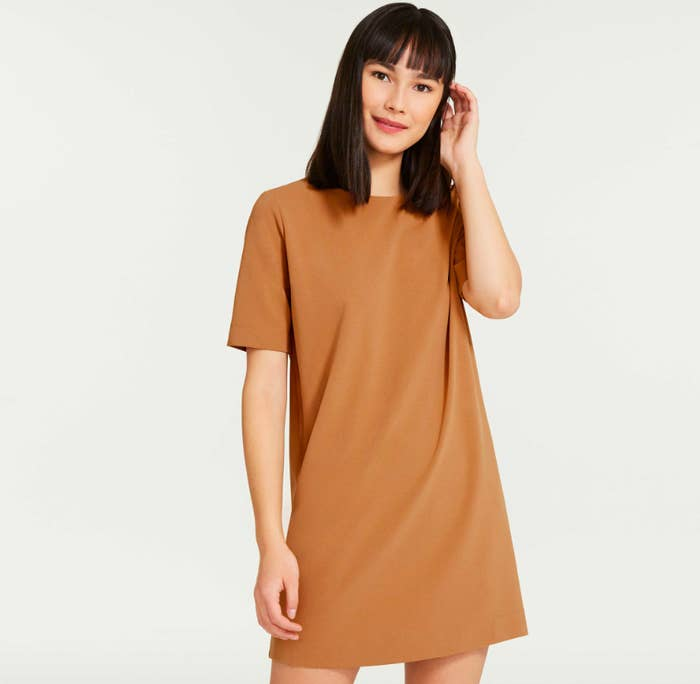A person wearing a loose-fitting T-shirt dress