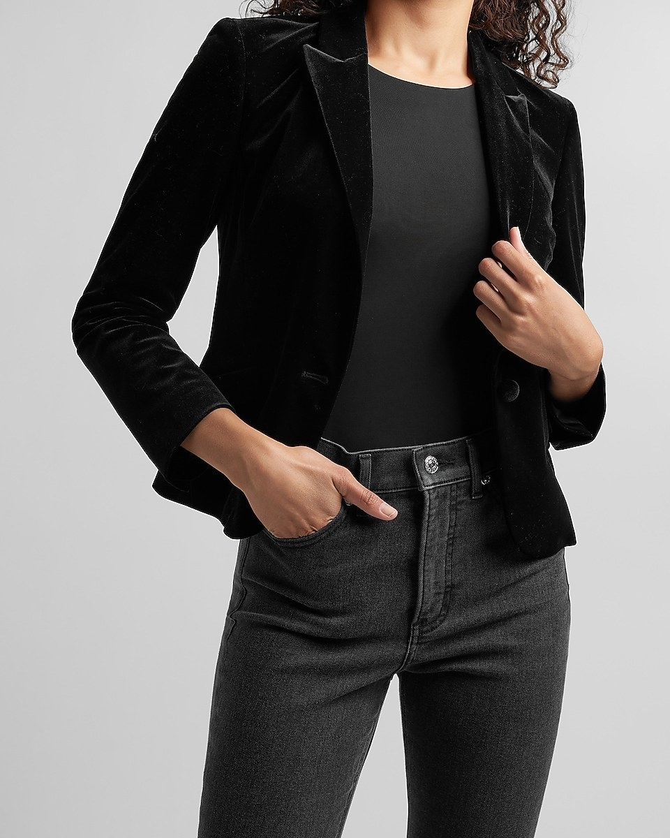 model wearing the black velvet blazer