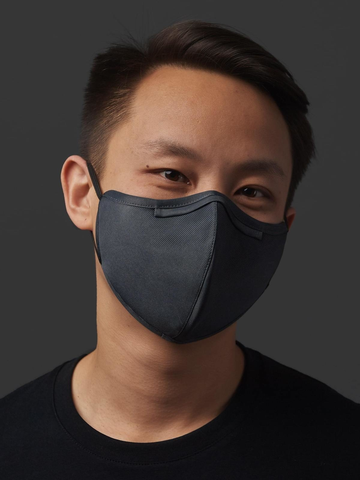a model wears the gray VO mask