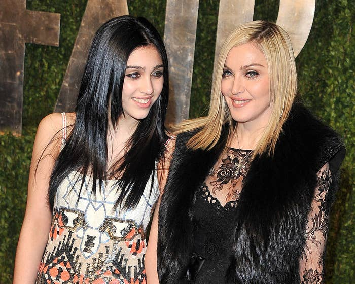 Lourdes and Madonna posing for photos at an event