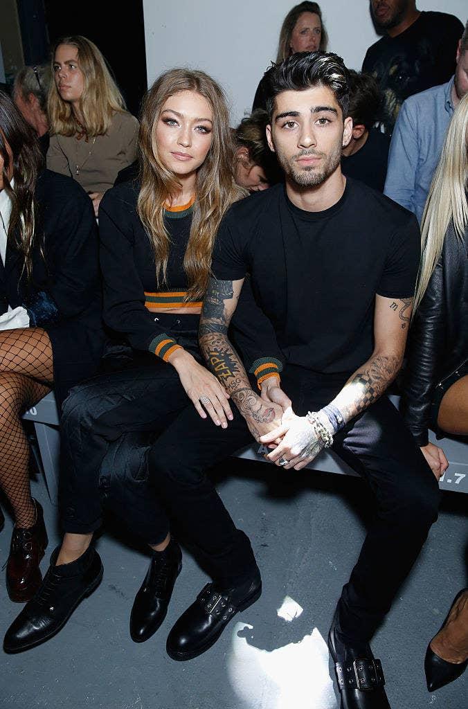 Gigi and Zayn posing for photos at a fashion show