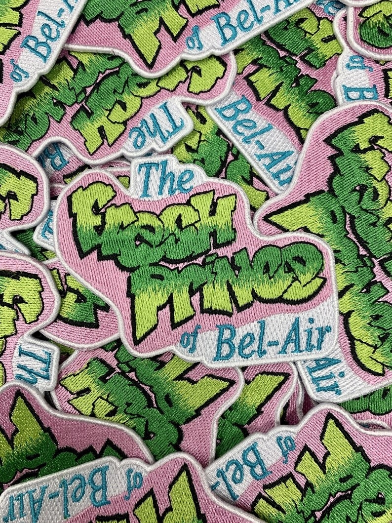 the green, pink, and blue logo patch that says The Fresh Prince of Bel-Air