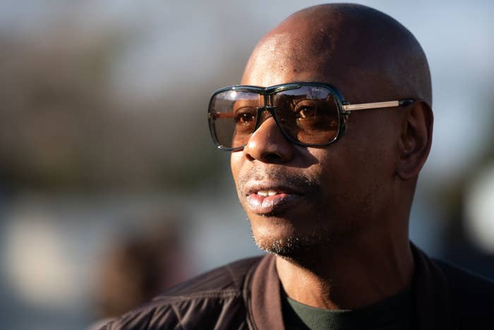 Comedian Dave Chappelle wears sunglasses as he campaigns for Democratic presidential candidate Andrew Yang