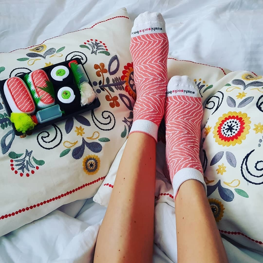 A person wearing a pair of printed socks