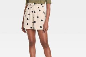 Model in high-rise paper bag shorts